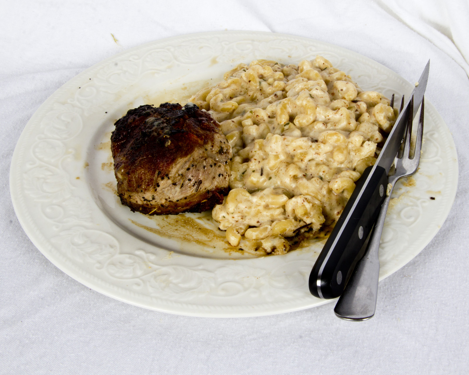 Bacon-fried pork chops with Parmesan macaroni and cheese