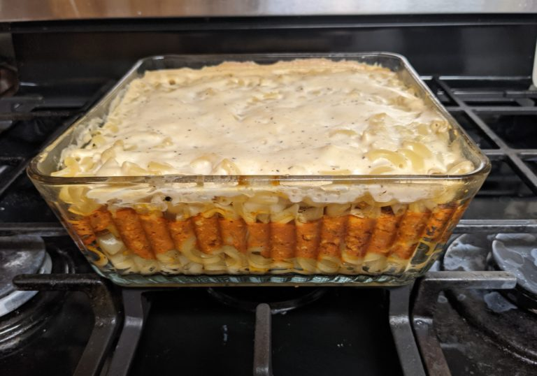 Casserole dish with noodles, sauce, and bechamel layers